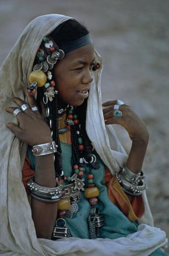 A Berber woman wears her prized silver jewelry at a friend's wedding.